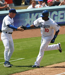 Los Angeles Dodgers' Wilson Betemit gets a quick five as he runs by third base coach  Rich Donnelly after hitting a solo homer in the 7th inning against the Cubs' Carlos Zambrano during the game played on Saturday, May 26, 2007 in Los Angeles, CA.  John Lazar / L.A. Daily News Staff Photographer
