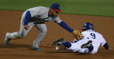 Los Angeles Dodgers' Juan Pierre gets tagged out at second base by Cubs' Cesar Izturis in the third inning of the game played on Friday, May 25, 2007 in Los Angeles, CA.  John Lazar / L.A. Daily News Staff Photographer