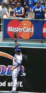 Los Angeles Dodgers' Andre Ethier reaches for the first of two homers hit back-to-back in the second inning by Cubs batters against losing pitcher Mark Hendrickson in the game played on Saturday, May 26, 2007 in Los Angeles, CA.  John Lazar / L.A. Daily News Staff Photographer