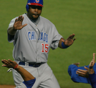 Cubs' Cliff Floyd gets high-fived after getting home making the score 7-5 in the 7th inning against the Dodgers during the game played on Friday, May 25, 2007 in Los Angeles, CA.  John Lazar / L.A. Daily News Staff Photographer