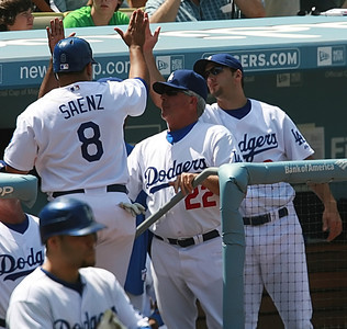 Los Angeles Dodgers' Olmedo Saenz gets high-fives as he comes in from having scored the second run of the game played against the Cubs in the game played on Saturday, May 26, 2007 in Los Angeles, CA.  John Lazar / L.A. Daily News Staff Photographer