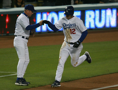 Los Angeles Dodgers' Jeff Kent gets a knuckle as he runs by third-base coach Rich Donnelly after hitting a two-run homer in the third inning against the Cubs in the game played on Friday, May 25, 2007 in Los Angeles, CA.  John Lazar / L.A. Daily News Staff Photographer