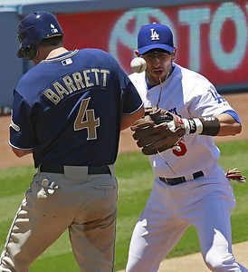Los Angeles Dodgers' Nomar Garciaparra looks at a the ball bounce off the back of San Diego Padres' Michael Barrett as he reaches third base after a bad throw toward third base in the second inning of the game played at Dodgers Stadium in Los Angeles, CA, on Sunday, July 1, 2007 where the Dodgers won with the final score of 5-0.   (John Lazar/L.A. Daily News Staff Photographer)
