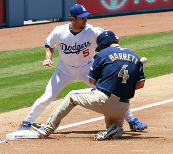 Los Angeles Dodgers' Nomar Garciaparra looks at a bad throw coming toward him as it hits the back of San Diego Padres' Michael Barrett as he reaches third base in the second inning of the game played at Dodgers Stadium in Los Angeles, CA, on Sunday, July 1, 2007 where the Dodgers won with the final score of 5-0.   (John Lazar/L.A. Daily News Staff Photographer)