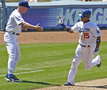 Los Angeles Dodgers' Rafael Furcal reaches out to give third-base coach Rich Donnelly a 5 as he runs by after hitting a solo homer against San Diego Padres in the seventh inning of the game played at Dodgers Stadium in Los Angeles, CA, on Sunday, July 1, 2007 where the Dodgers won with the final score of 5-0.   (John Lazar/L.A. Daily News Staff Photographer)