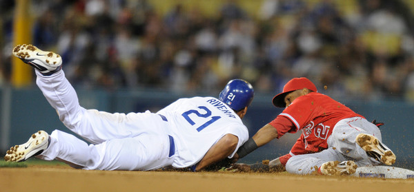 Juan Rivera is caught diving back to 2nd base after a Tony Gwynn single Maicer Izturis made the tag in the 2nd inning. Dodgers played host to the Angels in a pre-season game that is known as the Freeway Series. Los Angeles, CA 4/3/2012(John McCoy/Staff Photographer)