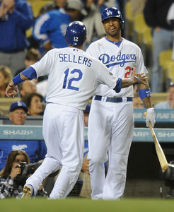 Justin Sellers is congratulated for scoring a run by Matt Kemp in the 6th inning. Dodgers played host to the Angels in a pre-season game that is known as the Freeway Series. Los Angeles, CA 4/3/2012(John McCoy/Staff Photographer)