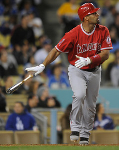 Albert Pujols hits a sacrifice fly in the 6th inning. Dodgers played host to the Angels in a pre-season game that is known as the Freeway Series. Los Angeles, CA 4/3/2012(John McCoy/Staff Photographer)