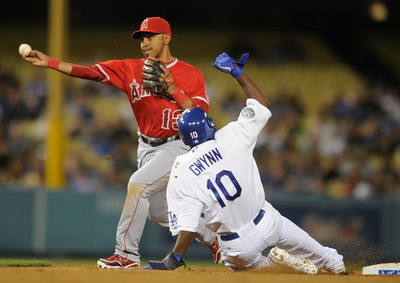 Tony Gywnn is caught in a double play to end the 4th inning while Angels Maicer Izturis makes the throw to first base. Dodgers played host to the Angels in a pre-season game that is known as the Freeway Series. Los Angeles, CA 4/3/2012(John McCoy/Staff Photographer)