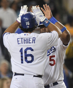 Andre Ethier is congratulaed by Juan Uribe after Ethier hit a 2 run homer in the 5th inning. The Dodgers hosted the Detroit Tigers in a game at Dodger Stadium. Los Angeles, CA 6-21-2011. (John McCoy/Staff Photographer)