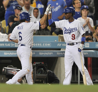 Dodgers #6 Aaron Miles is congratulated by #9 Dee Gordon after Miles was driven in on a Tony Gywynn Jr. single in the 4th inning.  The Dodgers hosted the Detroit Tigers in a game at Dodger Stadium. Los Angeles, CA 6-21-2011. (John McCoy/Staff Photographer)
