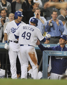 Trent Oeltjen is congratulated by Andre Either and Dodger Manager Don Mattingly after Oeltjen scored on a hit by Dee Gordon in the 7th inning. The Dodgers hosted the Detroit Tigers in a game at Dodger Stadium. Los Angeles, CA 6-21-2011. (John McCoy/Staff Photographer)