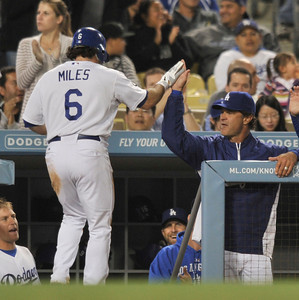Aaron Miles is congratulated by Don Mattingly after being driven in by Tony Gywynn Jr. in the 4th inning.  The Dodgers hosted the Detroit Tigers in a game at Dodger Stadium. Los Angeles, CA 6-21-2011. (John McCoy/Staff Photographer)