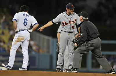 Tigers #25 Ryan Raburn argues with 2nd base umpire Dana DeMuth after he got the throw late and was not able to pick off Dodgers #6 Aaron Miles in the 4th inning. James Loney had been caught in a rundown between 2nd and 3rd base on the same play. The Dodgers hosted the Detroit Tigers in a game at Dodger Stadium. Los Angeles, CA 6-21-2011. (John McCoy/Staff Photographer)