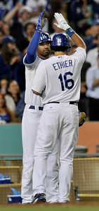 Matt Kemp congratulates Andre Ethier on his 2 run homer in the 5th inning. The Dodgers hosted the Detroit Tigers in a game at Dodger Stadium. Los Angeles, CA 6-21-2011. (John McCoy/Staff Photographer)