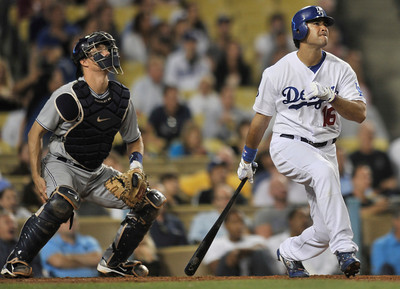 Padres catcher Nick Hundley and Dodgers Andre Ethier watch Ethiers grand slam leave the park in the 2nd inning. The Dodgers played host to the San Diego Padres in a game played at Dodger Stadium in Los Angeles, CA. 8-30-2011. (John McCoy/Staff Photographer)