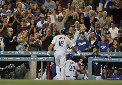 Andre Ethier is congratulated by Dodger Manager Don Mattingly and the crowd behind the dugout after a 2nd inning grand slam. The Dodgers played host to the San Diego Padres in a game played at Dodger Stadium in Los Angeles, CA. 8-30-2011. (John McCoy/Staff Photographer)