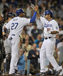 Matt Kemp congratulates Andre Ethier on his 2nd inning grand slam. The Dodgers played host to the San Diego Padres in a game played at Dodger Stadium in Los Angeles, CA. 8-30-2011. (John McCoy/Staff Photographer)
