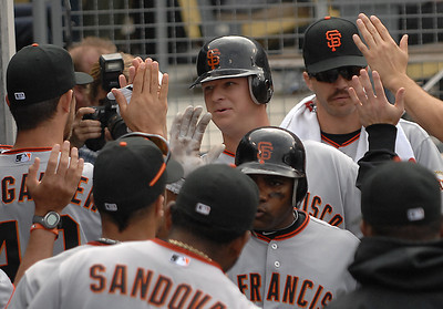 Matt Cain is congratulated by his team mates after he was driven in in the 6th inning. The Los Angeles Dodgers hosted the San Francisco Giants in a game at Dodger Stadium in Los Angeles, CA 4-1-2011. (John McCoy/staff photographer)