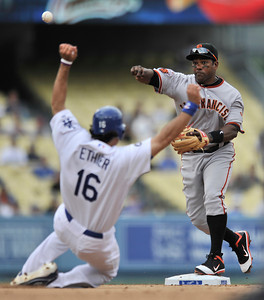 Giants SS Miguel Tejada throws to first after catching Andre Ethier in a 4th inning double play. The Los Angeles Dodgers hosted the San Francisco Giants in a game at Dodger Stadium in Los Angeles, CA 4-1-2011. (John McCoy/staff photographer)