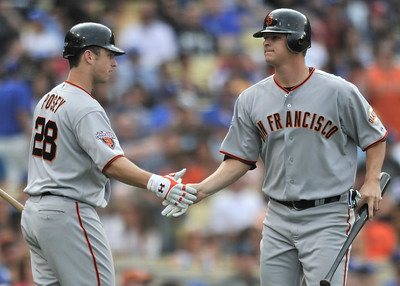 Giants Buster Posey congratulates pitcher Matt Cain after he was driven in for a run in the 6th inning. The Los Angeles Dodgers hosted the San Francisco Giants in a game at Dodger Stadium in Los Angeles, CA 4-1-2011. (John McCoy/staff photographer)