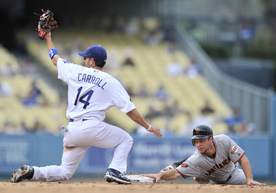 Jamey Carroll gets the throw late, and can not catch Brandon Belt who stole 2nd base in the 6th inning. The Los Angeles Dodgers hosted the San Francisco Giants in a game at Dodger Stadium in Los Angeles, CA 4-1-2011. (John McCoy/staff photographer)