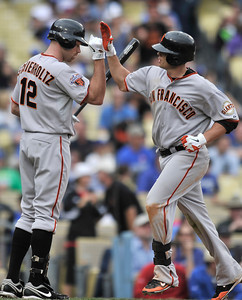 Giants Nate Schierholtz congratulates Freddy Sanchez on his 8th inning solo homer.The Los Angeles Dodgers were defeated 10-0 by the San Francisco Giants in a game at Dodger Stadium in Los Angeles, CA 4-1-2011. (John McCoy/staff photographer)