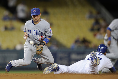 Matt Kemp steals second base as Cubs Darwin Barney fumbles the throw in the 6th ining. Dodgers played host to the Chicago Cubs in a game at Chavez Ravine. Los Angeles, CA 5-3-2011. (John McCoy/staff photographer)