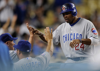 Cubs Marlon Byrd is congratulated after being driven in on a double by Geovany Soto in the 9th inning. The Dodgers lost to the Chicago Cubs 4-1 in a game at Chavez Ravine. Los Angeles, CA 5-3-2011. (John McCoy/staff photographer)