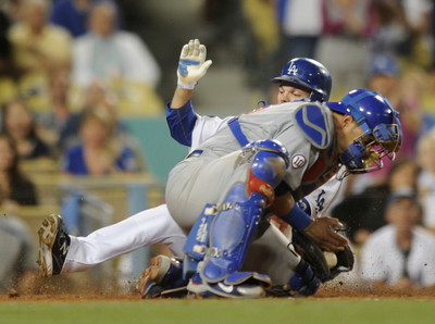 Jamey Carroll makes it safely home as Cubs Catcher Geovany Soto gets the throw late in the 6th inning. The Dodgers lost to the Chicago Cubs  4-1 in a game at Chavez Ravine. Los Angeles, CA 5-3-2011. (John McCoy/staff photographer)