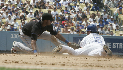 Dodgers' Rafael Furcal was tagged out at second base by New York Mets' Jose Reyes during the bottom of 4th inning on Sunday, July 22, 2007 at Dodger Stadium. (Edna T. Simpson)