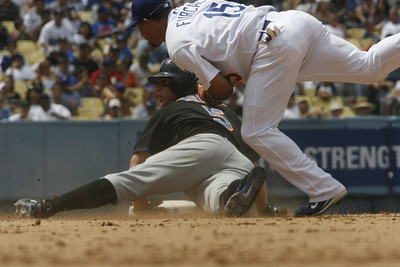 Dodgers' Rafael Furcal could not make it in time to tag out New York Mets' David Wright at second base during the sixth inning on Sunday, July 22, 2007 at Dodger Stadium. (Edna T. Simpson)