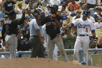 Dodgers' Nomar Garciaparra could not make the tag on New York Mets' Jose Reyes as he makes it to third base in the 6th inning on Sunday, July 22, 2007 at Dodger Stadium. (Edna T. Simpson)