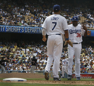 Dodgers RHP, Roberto Hernandez injuried his hand after throwing the ball to first baseman James Loney to tag New York Mets' Lastings Milledge out at first base during the top of 8th inning on Sunday, July 22, 2007 at Dodger Stadium. (Edna T. Simpson)
