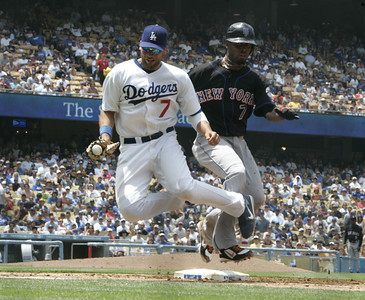 Dodgers' James Loney tags out New York Mets' Jose Reyes at first base in the third ending of the game on Sunday, July 22, 2007 at Dodger Stadium. (Edna T. Simpson)