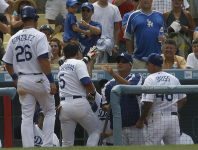 Dodgers' Nomar Garciaparra and Luis Gonzalez celebrate with coaches and teammates after scoring in two runs in the 6th inning on Sunday, July 22, 2007 at Dodger Stadium. (Edna T. Simpson)