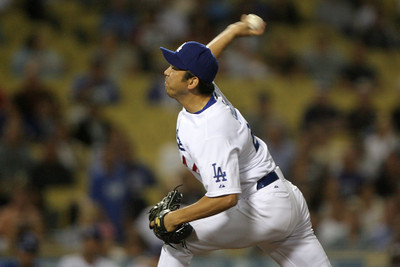 CLOSER--Dodger pitcher Takashi Saito takes out the Padres in the top of the ninth to win the game for the Dodgers 6-3.      Photo by David Crane/Staff Photographer.