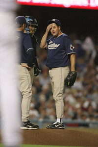 BAD NIGHT AT THE OFFICE--Padres pitcher Greg Maddux wipes his brow as the Dodgers score 3 runs in the third inning.   Photo by David Crane/Staff Photographer.