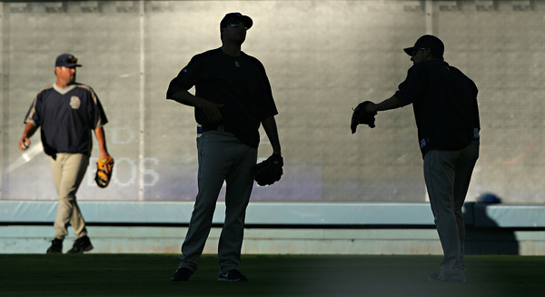 SHADOW PLAY--Members of the San Diego Padres warm up in left field at Dodger stadium thursday before they faced the Dodgers.   Photo by David Crane/Staff Photographer.