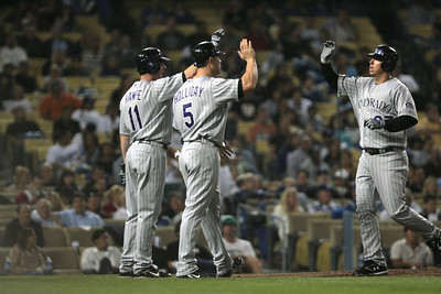 DODGERS VS ROCKIES--Rockies Garrett Atkins, 27, is welcomed at home by Brad Hawpe and Matt Holliday.  Atkins hit the two run homer in the 4th at Dodger Stadium.   Photo by David Crane/Staff Photographer.