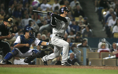 DODGERS VS ROCKIES--Rockies Kazuo Matsui hits a single during 5th inning action at Dodger Stadium.   Photo by David Crane/Staff Photographer.