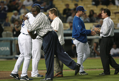 DODGERS VS ROCKIES--Former Dodgers, L to R, Dusty Baker, Ron Cey and Steve Garvey from the Dodgers 1977 team throw out the first pitch at Dodger stadium for the game against the Colorado Rockies.   Photo by David Crane/Staff Photographer.