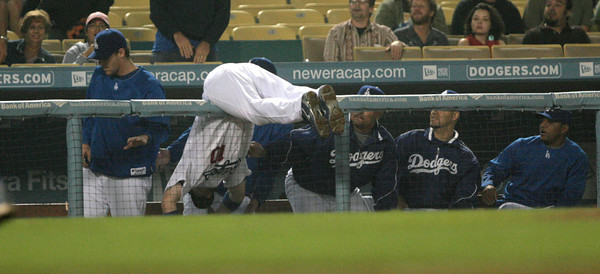 DODGERS VS ROCKIES--Dodger 3rd baseman Andy LaRoche, 10, falls into the dougout chasing after a foul ball during 8th inning action at Dodger Stadium.   Photo by David Crane/Staff Photographer.