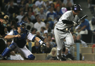 DODGERS VS ROCKIES--Rockies Franklin Morales bunts foul during 5th inning action at Dodger Stadium.   Photo by David Crane/Staff Photographer.