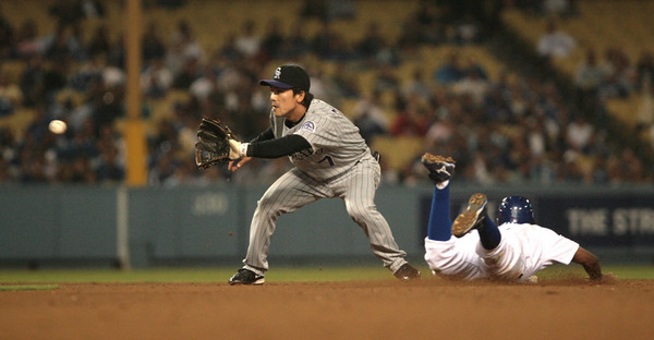 DODGERS VS ROCKIES--Dodgers Juan Pierre steals second as Rockies Kazuo Matsui can't make the play during 6th inning action at Dodger Stadium.   Photo by David Crane/Staff Photographer.