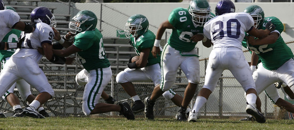 Eagle Rock defense makes running room for Andrew Trejo during the game against Bell High School  on Friday, September 21, 2007  Eagle Rock won 28-0 (Edna T. Simpson)