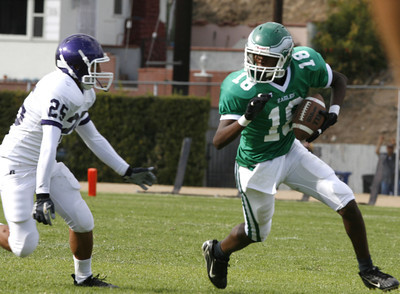 Eagle Rock #18 looks for some running room as he gains yardage in front of Bell's Jeffrey Lopez during the second quarter on Friday, September 21, 2007 at Eagle Rock High School. (Edna T. Simpson)