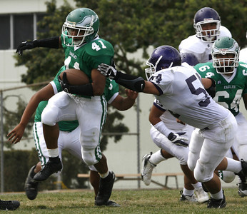 Eagle Rock Andrew Trejo breaks away from Bell's Omar Flores during the second quarter of victory game on Friday, September 21, 2007 at Eagle Rock High School. (Edna  T. Simpson)