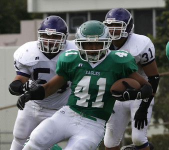 Eagle Rocks' Andrew Trejo gains yardage in front of Bell's#54 Omar Flores and #31 Miguel Muniz during the game on Friday, September 21, 2007 at Eagle Rock High School. (Edna T. Simpson)