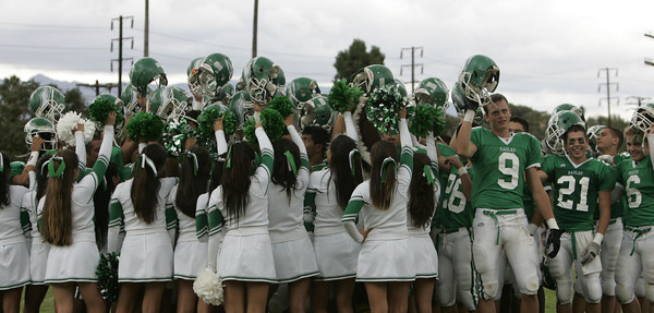 Eagle Rock Football Players and Cheerleaders celebrate after winning against Bell Eagles on Friday, September 21, 2007 at Eagle Rock High School. (Edna T. Simpson)